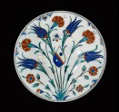 Dish with flower sprays and coat of arms, Turkey (Iznik), c.1570, Presented by C. D. E. Fortnum, 1888 (Museum no: WA1888.CDEF.C324) [image only].