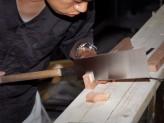 Tea house carpenter Okino Shōta sawing. © Ashmolean Museum, University of Oxford
