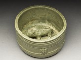 Greenware burial figure of pig in a pen (oblique)
