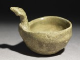 Greenware ladle with handle in the form of a bird-head (oblique)