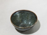 Black ware tea bowl with &#039;tortoiseshell&#039; glazes (oblique)