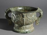 Ritual food vessel, or gui, with coiled figures and taotie masks