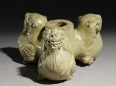 Greenware stand in the form of three lions (oblique)