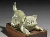 Greenware burial figure of a dog (oblique)