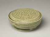 Greenware circular box and lid with floral design (oblique)