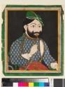 Bearded man wearing a green turban