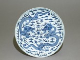 Blue-and-white dish with dragons chasing a flaming pearl (top)