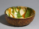Bowl with floral decoration and three-colour glaze