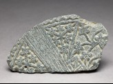 Lid fragment with floral decoration