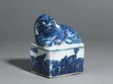 Blue-and-white seal surmounted by a shishi, or lion dog (side)
