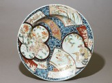 Dish with a shishi, or lion dog, amid animals and flowers (top)