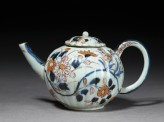 Small fluted teapot with floral decoration
