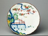 Petalled plate depicting prunus and camellia growing by a terrace