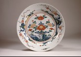Dish with peonies on a terrace