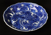 Blue-and-white dish with animals amid waves