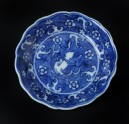 Blue-and-white dish with horse amid waves, and Prunus blossoms (EA1978.907)