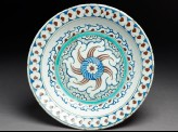 Dish with whirling rosette and prunus blossom