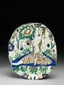 Base fragment of a dish with woman combing her hair