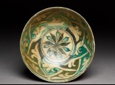 Bowl with rosette and interlaced tendrils