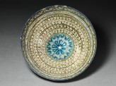 Bowl with vegetal decoration and central rosette