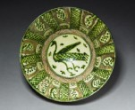 Bowl with bird and spotted leaves