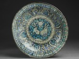 Dish with hares against a foliate background