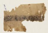 Textile fragment with naskhi inscription and scrolls, probably from a garment