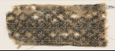 Textile fragment with linked diamond-shapes and interlaced crosses (EA1984.203)