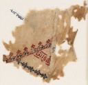 Textile fragment with linked crenellations and inscription (EA1984.217)