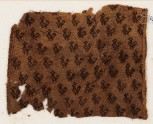 Textile fragment with birds with curving tails, probably from a tunic (EA1984.221)