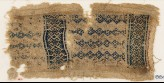 Textile fragment with linked diamond-shapes, hooks, squares, and crosses (EA1984.239)