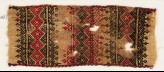 Textile fragment with bands of linked squares, crosses, triangles, and leaves (EA1984.242)
