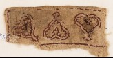 Textile fragment with leaves and palmettes, possibly from trousers or a collar (EA1984.263.b)