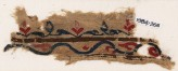 Textile fragment with vine and leaves (EA1984.266)