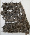 Textile fragment with linked diamond-shapes, hexagons, and pseudo-inscription (EA1984.272)