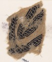 Textile fragment with linked scrolls of S-shapes, possibly from a garment (EA1984.290)