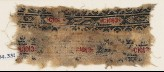 Textile fragment with bands of hexagonal cartouches, S-shapes, diamond-shapes, and crescents (EA1984.331)
