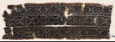Textile fragment with linked diamond-shapes and arrowheads (EA1984.344)