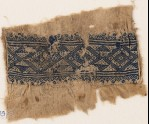 Textile fragment with linked diamond-shapes, triangles, and flowers (EA1984.349)