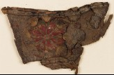 Textile fragment with rosette, possibly from a slipper (EA1984.356)