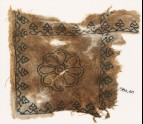 Textile fragment with rosette and palmettes, possibly from a cushion (EA1984.40)