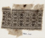 Textile fragment with vines, leaves, and flower-heads