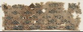 Textile fragment with diamond-shapes set into a diagonal grid (EA1984.567)