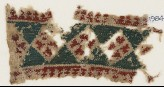 Textile fragment with diamond-shapes containing Maltese crosses (EA1984.576)