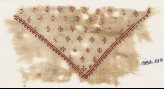 Textile fragment with row of hooks (EA1984.616)
