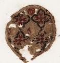 Roundel textile fragment with quatrefoils