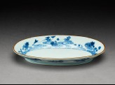 Dish with flowers and clouds