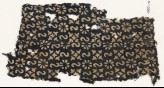 Textile fragment with reversed S-shapes, rosettes, and quatrefoils