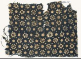 Textile fragment with rosettes, stars, and dots (EA1990.101)