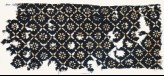 Textile fragment with flowers, dots, and rosettes